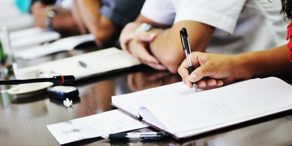business beople on meeting conference taking notes and make deal